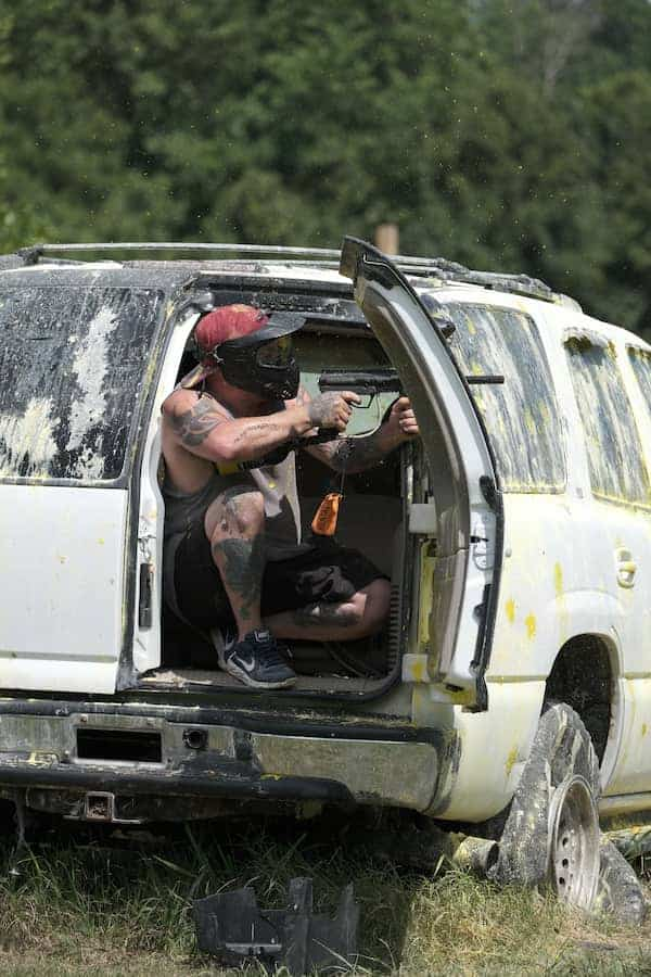 Paintball player shooting from back of SUV